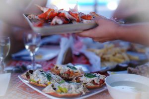Zanzibar Yacht Charter Catering preparing a crab dish.