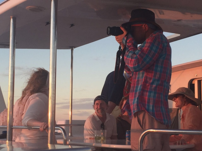 A guest shooting the Sunset on a yacht based photographic safari