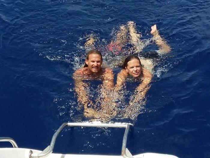 Swimming at Mnemba Island Day charter catamaran cruise.