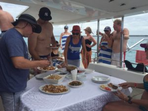 Zanzibar Corporate Events guests enjoying lunch onboard