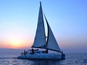 Sailing catamaran at Sunset