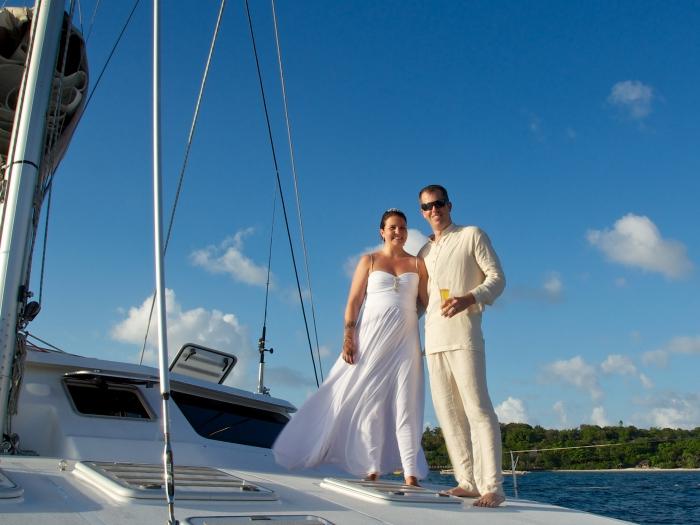 A couple enjoying their Zanzibar Yacht Weddings Honeymoon on a luxury catamaran yacht in Pemba Island, Tanzania.